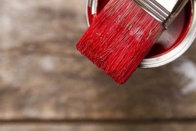 red paint and a brush